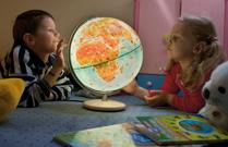 Kids Exploring Globe